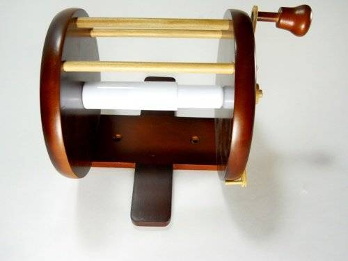 10 unique toilet paper holder designs that your bathroom for Fishing reel toilet paper holder