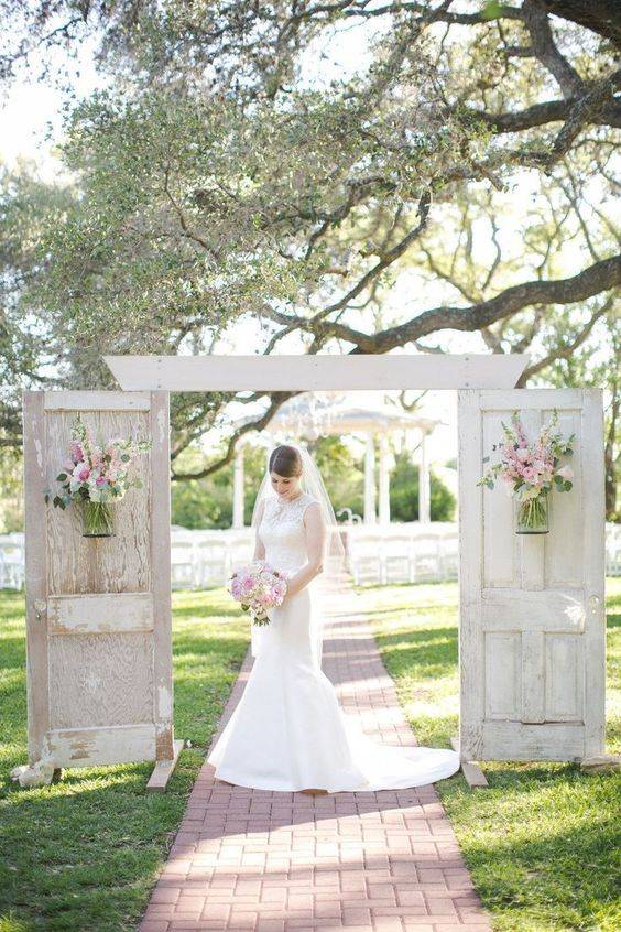 All White Wedding, Rustic Wodden Doors With Pink Flowers // 10 Rustic Old Door Wedding Decor Ideas For Outdoor Country Weddings