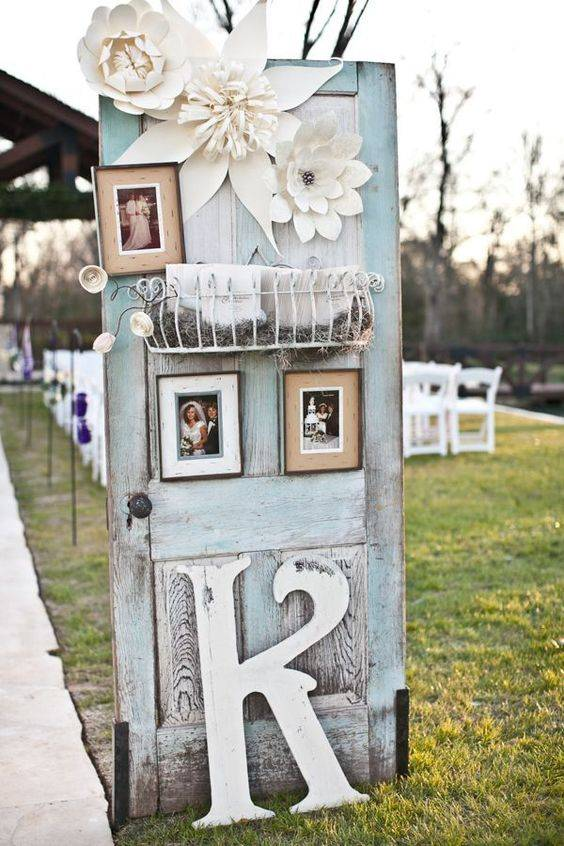 Blue Vintage Wedding Door With Photo Frames & White Flowers // 10 Rustic Old Door Wedding Decor Ideas For Outdoor Country Weddings
