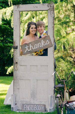 Photogenic Wedding Door, Holding Thanks Sign Through Empty Window // 10 Rustic Old Door Wedding Decor Ideas For Outdoor Country Weddings
