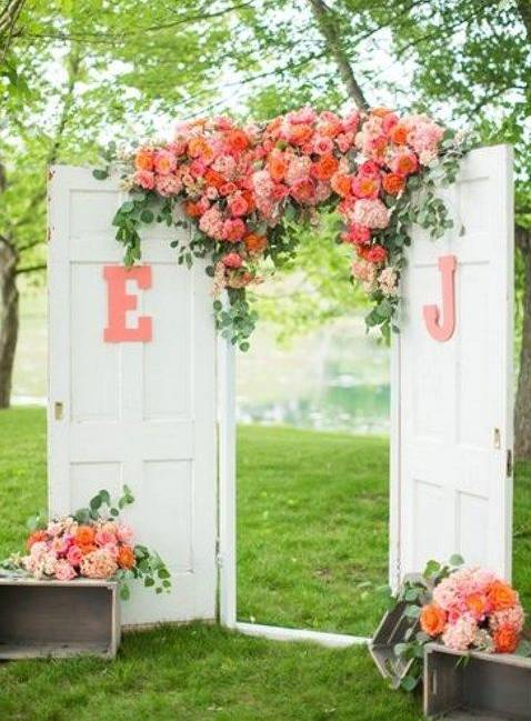 White Wedding Doors With Letter Initials, And Pink And Coral Flower Bouquet // 10 Rustic Old Door Wedding Decor Ideas For Outdoor Country Weddings